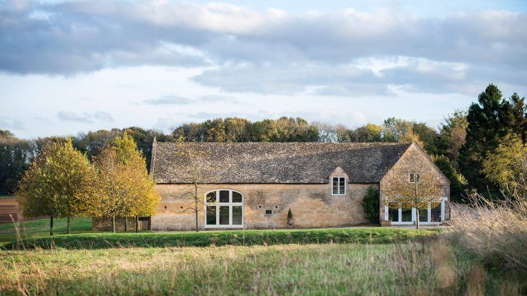Lapstone Barn exterior shot in late summer, now a stunning Cotswold wedding barn