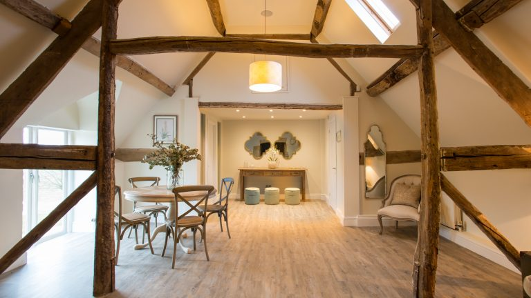 The Hayloft bridal area with its rustic rafters and wonky floorboards, truly adds to your Cotswold barn wedding experience