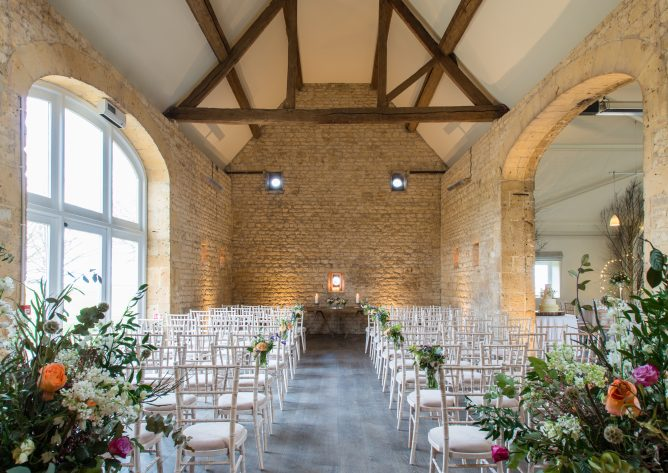 The 18th century Stone Barn is an idyllic setting for your Cotswold barn wedding with its exposed stone walls and soaring rafters