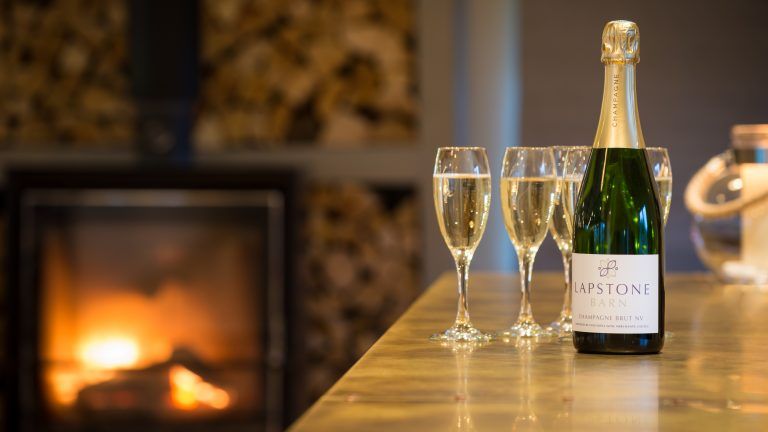 Glasses of champagne on the bar at Lapstone Barn