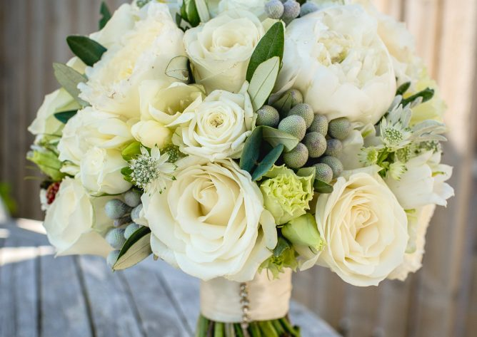 Hand tied bridal bouquet in whites and soft neutrals