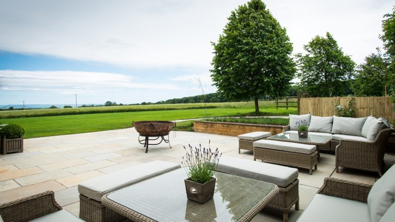 The south facing terrace with casual seating to enjoy the stunning Cotswold view