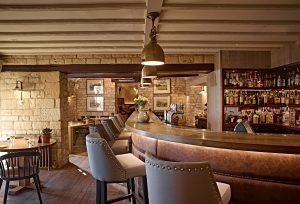The elegantly rustic Potting Shed restaurant at The Dormy House