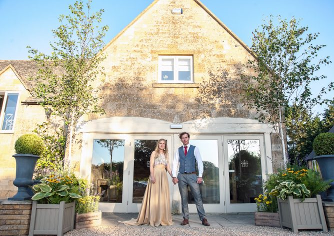 The first bride and groom at the front door of this new Cotswold wedding venue. Photo: Rachel Jones Photography