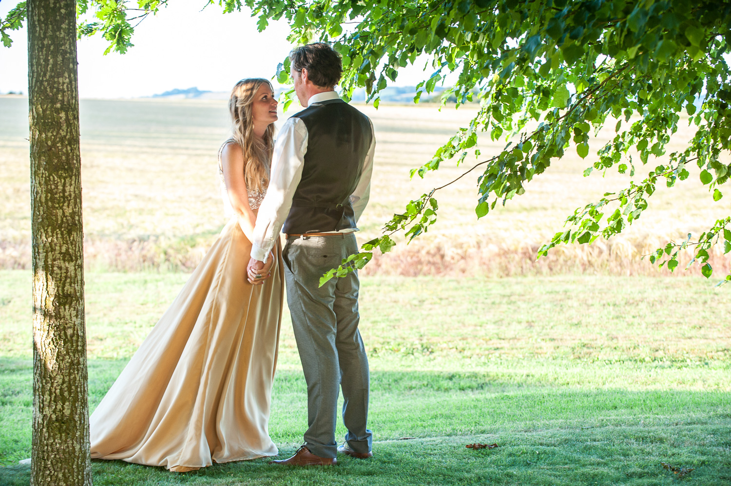 Bride and groom photographed outside this beautiful Cotswold wedding venue. Photography: Rachel Jones Photography