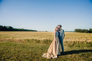 Bride and groom enjoying the amazing Cotswold views from this beautiful wedding venue