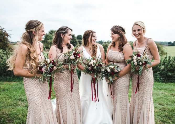 Bride and bridesmaids posing with their wedding bouquets