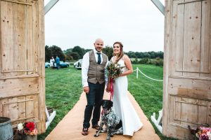 Bride and groom at the entrance to their wedding marquee