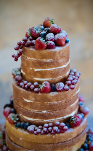 Naked wedding cake decorated with summer berries