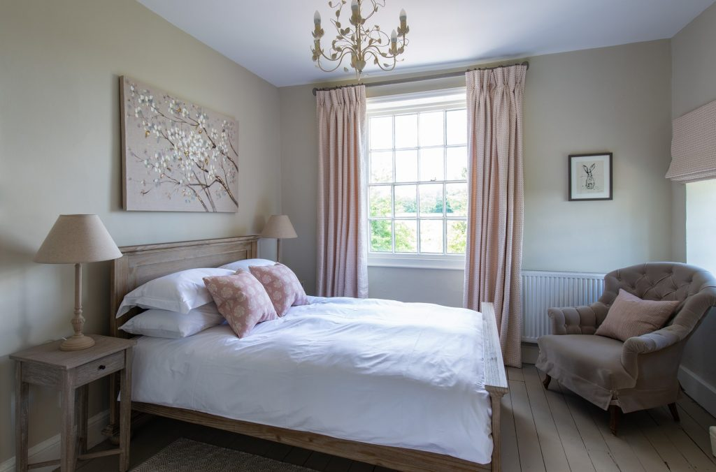 Double bedroom decorated in Cotswold style and available for your wedding night