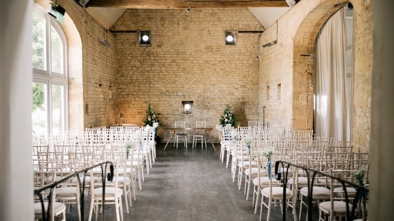 Stone Barn laid out with rows of chairs and set for the wedding ceremony