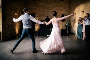 Bride and groom dancing their first dance routine during the wedding reception. Photography: Katie Hamilton Photography