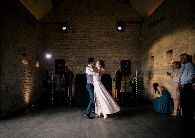 Bride and groom dancing together for their first dance. Photography: Katie Hamilton Photography