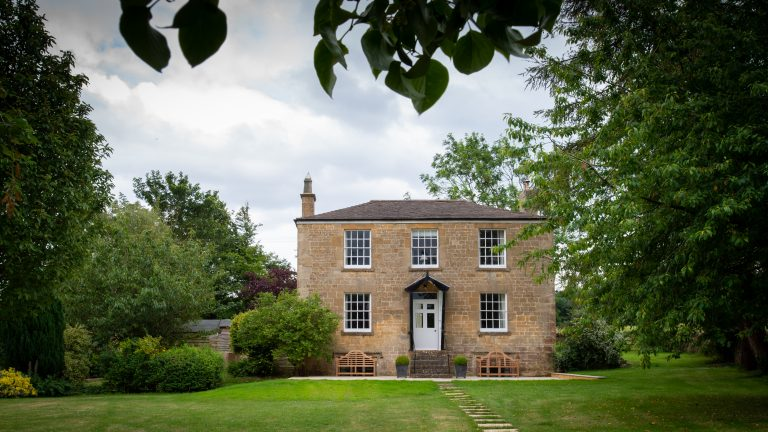 Exterior view of Lapstone Farmhouse, which provides on site accommodation at the wedding venue