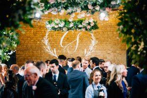 Hanging flower wheels over wedding guests on the dancefloor