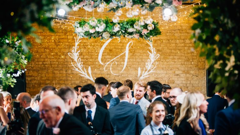 Hanging flower wheels over wedding guests on the dancefloor
