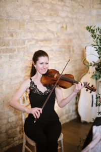 Classical violinist playing during the wedding ceremony