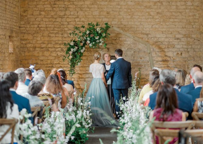 Bride and groom exchanging vows during their wedding ceremony