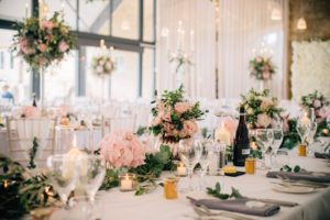 Wedding breakfast table decorated with pink flowers