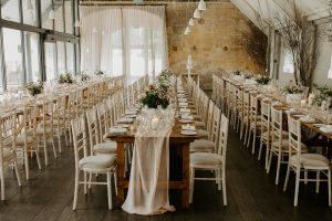 Long tables set for the wedding breakfast
